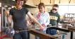 Kelly Howard helps glass blowers blow glass at Jennifer L Sears Glass Art Studio in Lincoln City