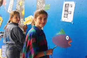 Mairead and Clare Alexander painting the mural