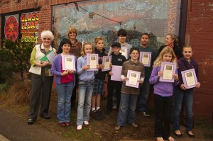Children receiving accolades for being part of the Let There Be Arts Salmon Mural project; photo by Jan Jackson